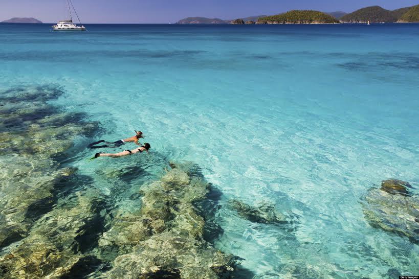 honeymoon couple snorkeling in the Caribbean waters