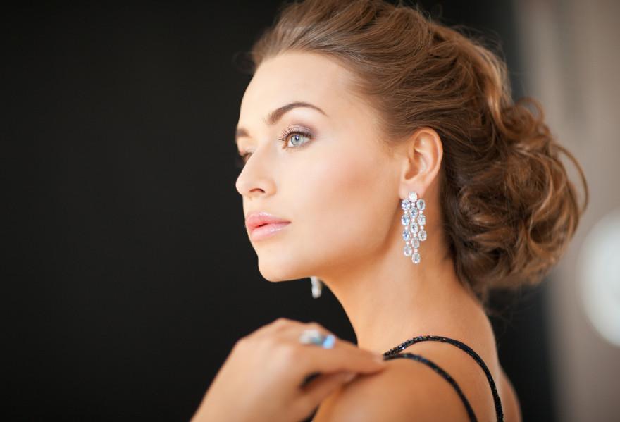 beautiful woman in evening dress wearing diamond earrings