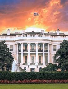 White House, under dramatic sky, sunset golden light, Washington DC